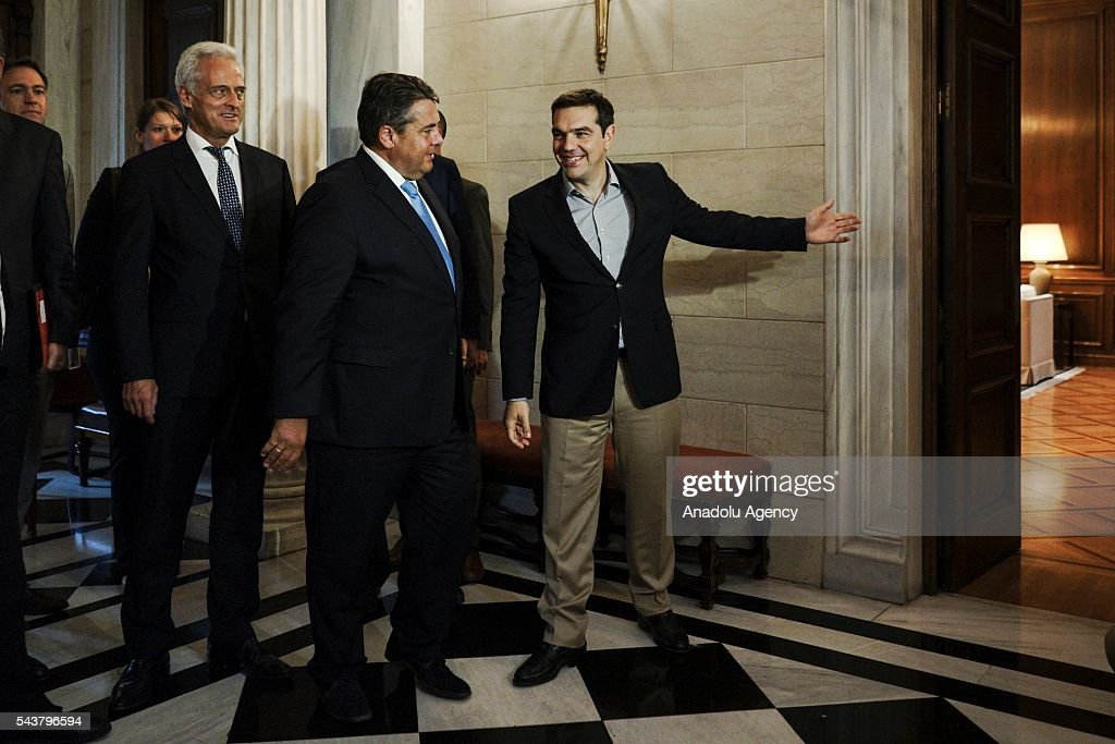 Greek Prime Minister Alexis Tsipras (R) meets German Economic Affairs and Energy Minister and Vice Chancellor, Sigmar Gabriel (R 2) at the Maximos Mansion in Athens, Greece on June 30, 2016.