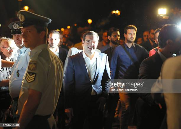 Greek Prime Minister Alexis Tsipras returns to his residence after visiting the President of Greece after the people of Greece rejected the debt...