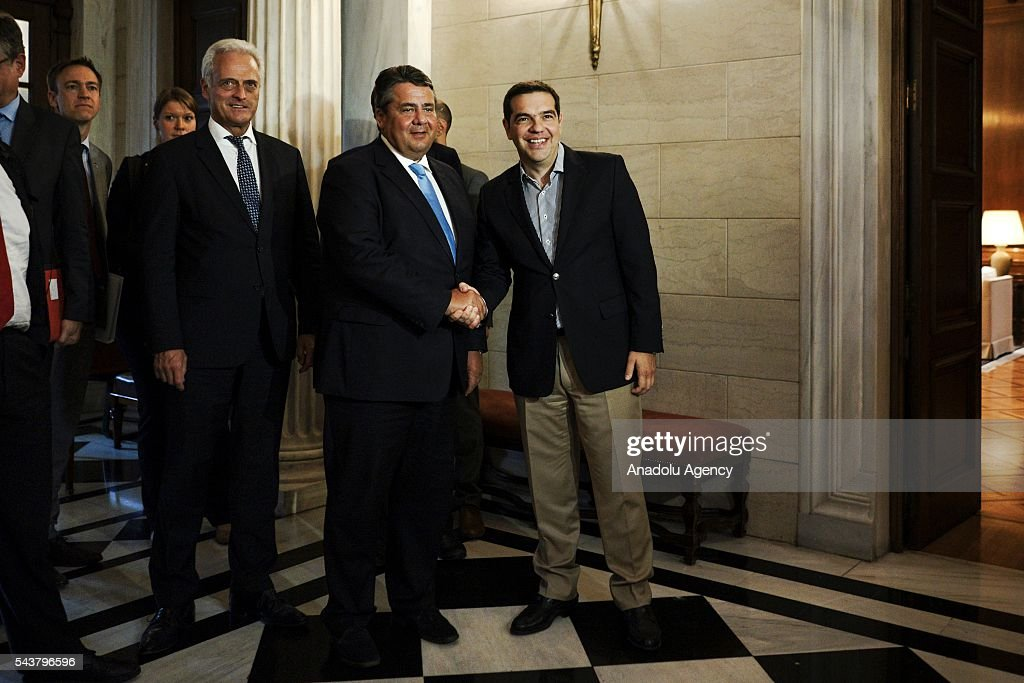 Greek Prime Minister Alexis Tsipras (R) shakes hands with German Economic Affairs and Energy Minister and Vice Chancellor, Sigmar Gabriel (R 2) at the Maximos Mansion in Athens, Greece on June 30, 2016.