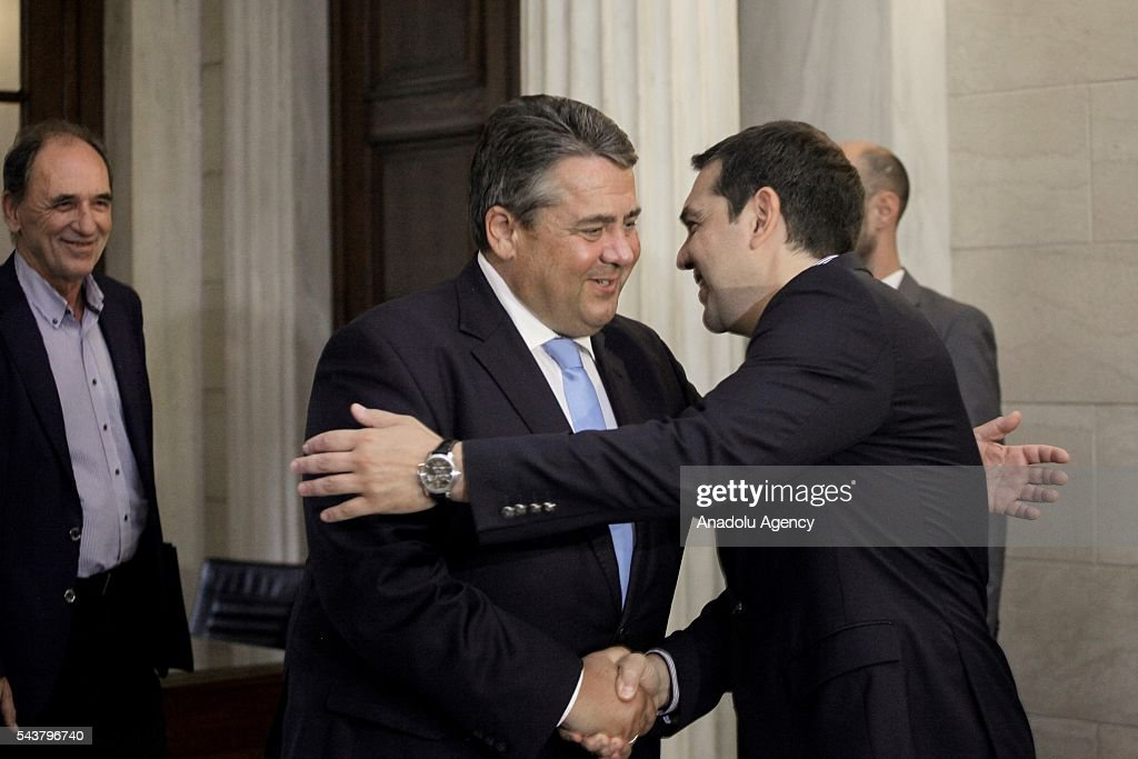 Greek Prime Minister Alexis Tsipras (L) shakes hands with German Economic Affairs and Energy Minister and Vice Chancellor, Sigmar Gabriel (L) at the Maximos Mansion in Athens, Greece on June 30, 2016.