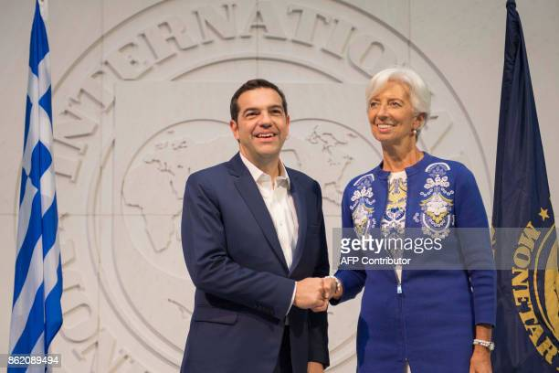 Greek Prime Minister Alexis Tsipras shakes hands with International Monetary Fund Managing Director Christine Lagarde at the IMF headquarters in...