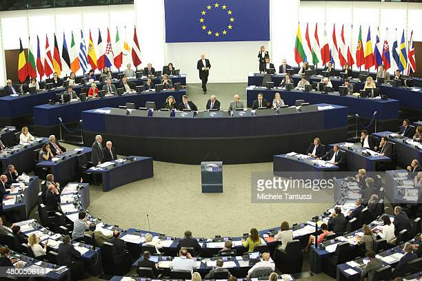 Greek Prime Minister Alexis Tsipras sits and listens as the president of the European commission Jean Claude Juncker speak at the European Parliament...