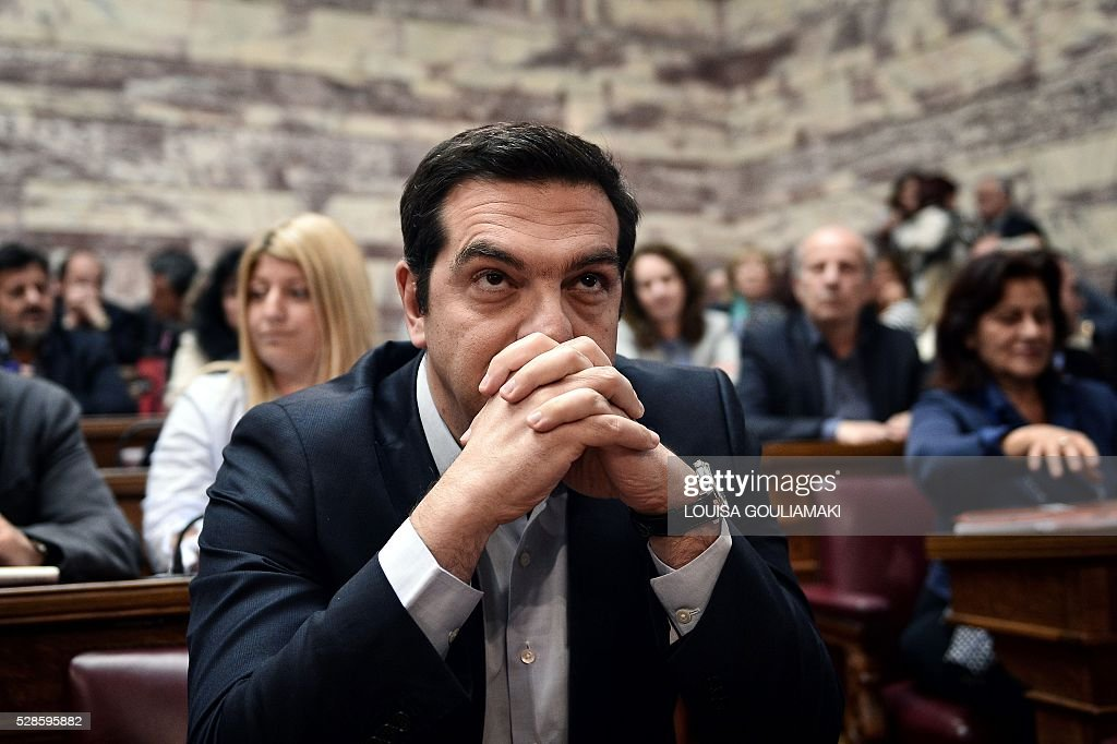 Greek Prime minister Alexis Tsipras sits during a Syriza party's parliamentary group at the Greek parliament in Athens on May 6, 2016. Greece's main labour unions staged a 48-hour strike to protest controversial government plans to overhaul pensions and increase taxes, as demanded by international creditors. The announcement on May 5, 2016 of a general strike came after Greece's parliament said the government's pension and taxation reform bills would be debated and voted on this weekend. / AFP / LOUISA