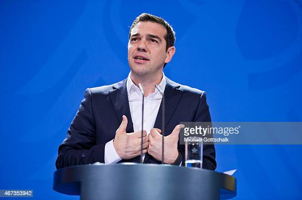 Greek Prime Minister Alexis Tsipras speaks to the media following talks with German Chancellor Angela Merkel at the German Chancellery on March 23...