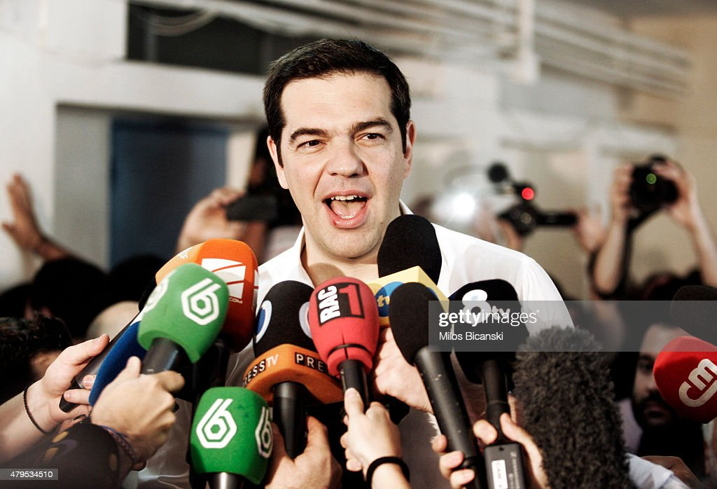 Greek Prime Minister <a gi-track='captionPersonalityLinkClicked' href=/galleries/search?phrase=Alexis+Tsipras&family=editorial&specificpeople=6592450 ng-click='$event.stopPropagation()'>Alexis Tsipras</a> speaks to the press after placing his vote in the austerity referendum at a local school in the suburbs of Athens on July 5, 2015 in Athens, Greece. The people of Greece are going to the polls to decide if the country should accept the terms and conditions of a bailout with its creditors. Greek Prime Minister <a gi-track='captionPersonalityLinkClicked' href=/galleries/search?phrase=Alexis+Tsipras&family=editorial&specificpeople=6592450 ng-click='$event.stopPropagation()'>Alexis Tsipras</a> is urging people to vote 'a proud no' to European creditors' proposals, and 'live with dignity in Europe'. 'Yes' campaigners believe that a no vote would mean financial ruin for Greece and the loss of the Euro currency.