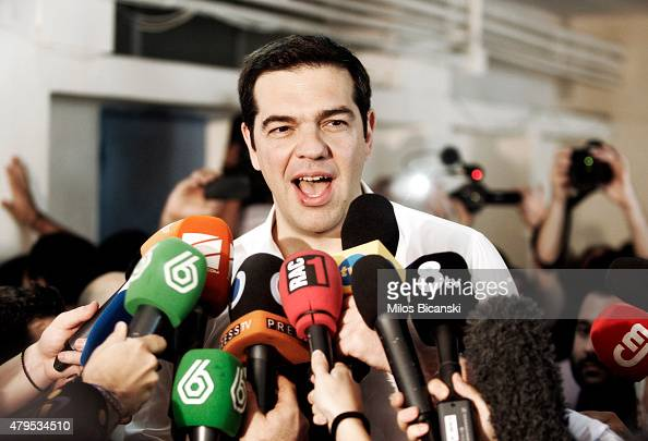 Greek Prime Minister Alexis Tsipras speaks to the press after placing his vote in the austerity referendum at a local school in the suburbs of Athens...