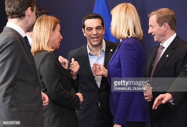 Greek Prime Minister Alexis Tsipras speaks with EU foreign policy chief Federica Mogherini Danish Prime Minister Helle ThorningSchmidt and Irish...