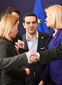 Greek Prime Minister Alexis Tsipras speaks with EU foreign policy chief Federica Mogherini and Danish Prime Minister Helle ThorningSchmidt as they...