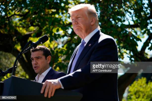 Greek Prime Minister Alexis Tsipras talks during a joint press conference with US President Donald Trump in the Rose Garden of the White House in...