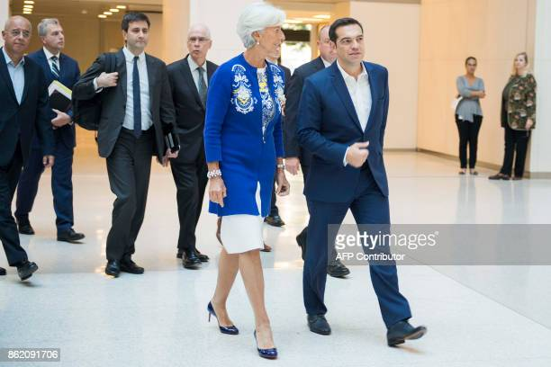 Greek Prime Minister Alexis Tsipras talks with International Monetary Fund Managing Director Christine Lagarde at the IMF headquarters in Washington...