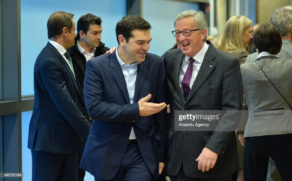 Greek Prime Minister <a gi-track='captionPersonalityLinkClicked' href=/galleries/search?phrase=Alexis+Tsipras&family=editorial&specificpeople=6592450 ng-click='$event.stopPropagation()'>Alexis Tsipras</a> (C) walks next to European Commission President <a gi-track='captionPersonalityLinkClicked' href=/galleries/search?phrase=Jean-Claude+Juncker&family=editorial&specificpeople=207032 ng-click='$event.stopPropagation()'>Jean-Claude Juncker</a> (R) at the European Commission headquarters in Brussels on February 4, 2015.