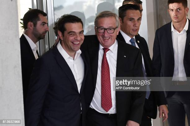 Greek Prime Minister Alexis Tsipras welcomes President of the European Commission JeanClaude Juncker for a meeting ahead of a ceremony to award...