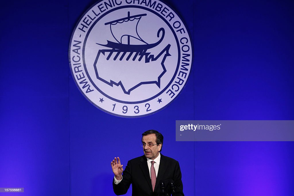Greek Prime Minister Antonis Samaras addresses the American-Hellenic Chamber of Commerce annual conference in Athens on December 4, 2012 on 'State reform-the cornerstone for Investment and Development.' Greece launched an operation to buy back privately held debt at a big discount, with eurozone finance ministers in Brussels studying the terms on offer alongside plans to bail out Cyprus too.