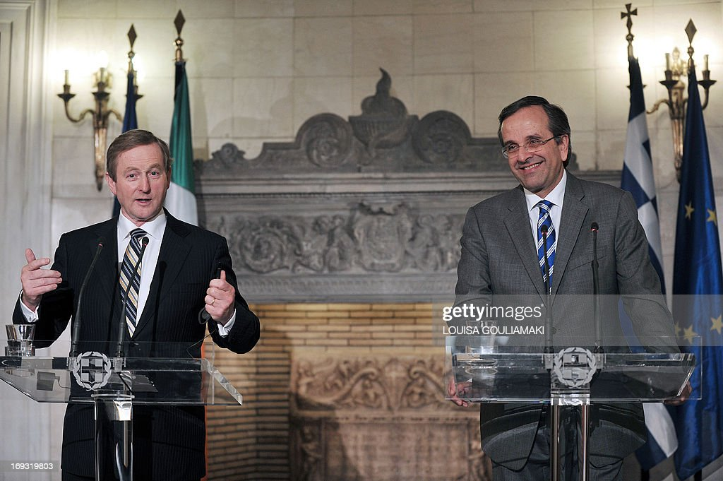 Greek Prime Minister Antonis Samaras (R) and his Irish counterpart, Enda Kenny, whose country has received an international bailout, speak to the media during a press conference in Athens as part of a working visit on May 23, 2013. AFP PHOTO/LOUISA GOULIAMAKI