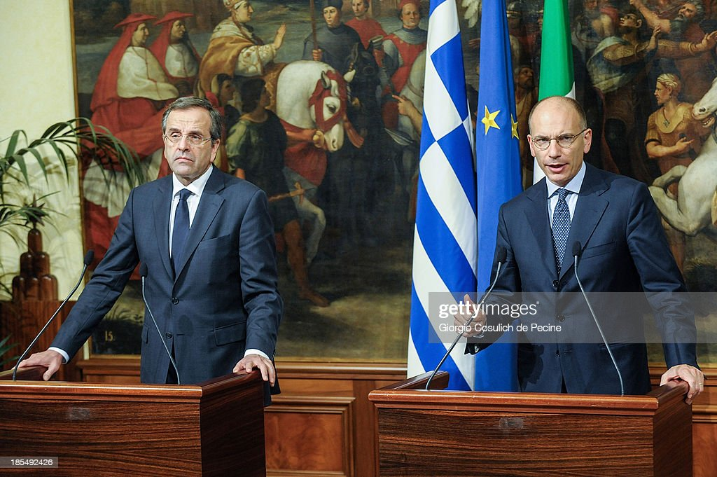 Greek Prime Minister <a gi-track='captionPersonalityLinkClicked' href=/galleries/search?phrase=Antonis+Samaras&family=editorial&specificpeople=970799 ng-click='$event.stopPropagation()'>Antonis Samaras</a> (L) and Italian Prime Minister <a gi-track='captionPersonalityLinkClicked' href=/galleries/search?phrase=Enrico+Letta&family=editorial&specificpeople=2915592 ng-click='$event.stopPropagation()'>Enrico Letta</a>, attend a press conference, after an official meeting at Palazzo Chigi on October 21, 2013 in Rome, Italy. During the meeting, the two Prime Ministers talked about immigration policy and European banking union.
