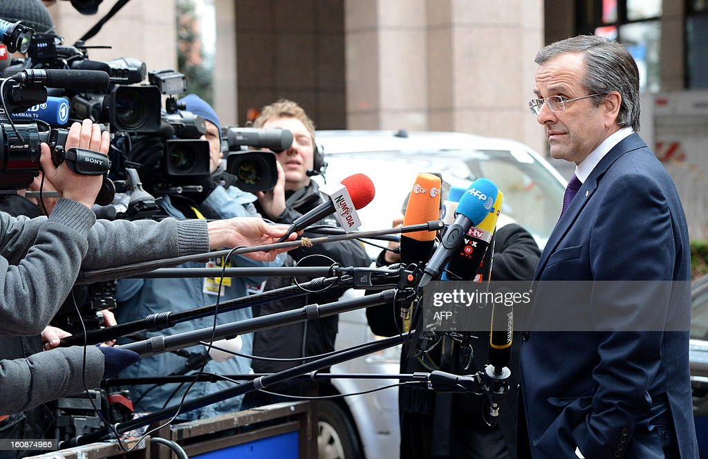 Greek Prime Minister Antonis Samaras arrives at the EU Headquarters on February 7, 2013 in Brussels, on the first day of a two-day European Union leaders summit. European Union leaders head into a fresh clash over the EU's budget with the only certainty being that proposals for several years will be cut back.