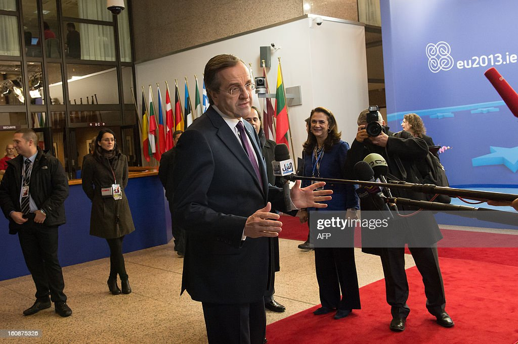 Greek Prime Minister Antonis Samaras arrives at the EU Headquarters on February 7, 2013 in Brussels, on the first day of a two-day European Union leaders summit. European Union leaders head into a fresh clash over the EU's budget with the only certainty being that proposals for several years will be cut back. AFP PHOTO / BERTRAND LANGLOIS
