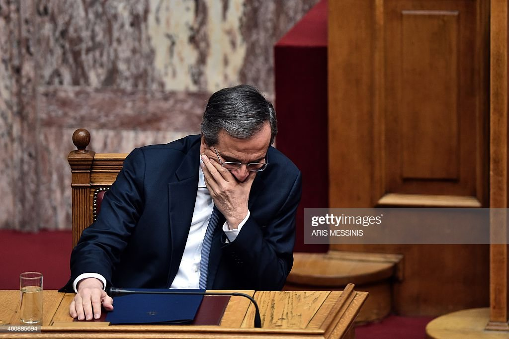 Greek Prime Minister Antonis Samaras attends the third round of a three-stage presidential election in the Greek parliament in Athens, on December 29, 2014. Greece's parliament on Monday failed for a third time to elect a president forcing early elections in the coming weeks that could see a radical left party win power. The government candidate fell short of securing the 180 votes required, and under the constitution parliament will have to be dissolved in the next 10 days. AFP PHOTO / ARIS MESSINIS