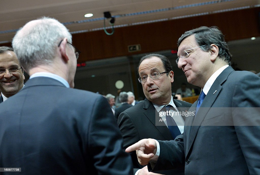 Greek Prime Minister Antonis Samaras, French President Francois Hollande, European Commission President Jose Manuel Barroso and EU Council president Herman Van Rompuy EU Council president Herman Van Rompuy chat during a roundtable meeting at the EU Headquarters on February 7, 2013 in Brussels, on the first day of a two-day European Union leaders summit. European Union leaders head into a fresh clash over the EU's budget with the only certainty being that proposals for several years will be cut back. AFP PHOTO / BERTRAND LANGLOIS