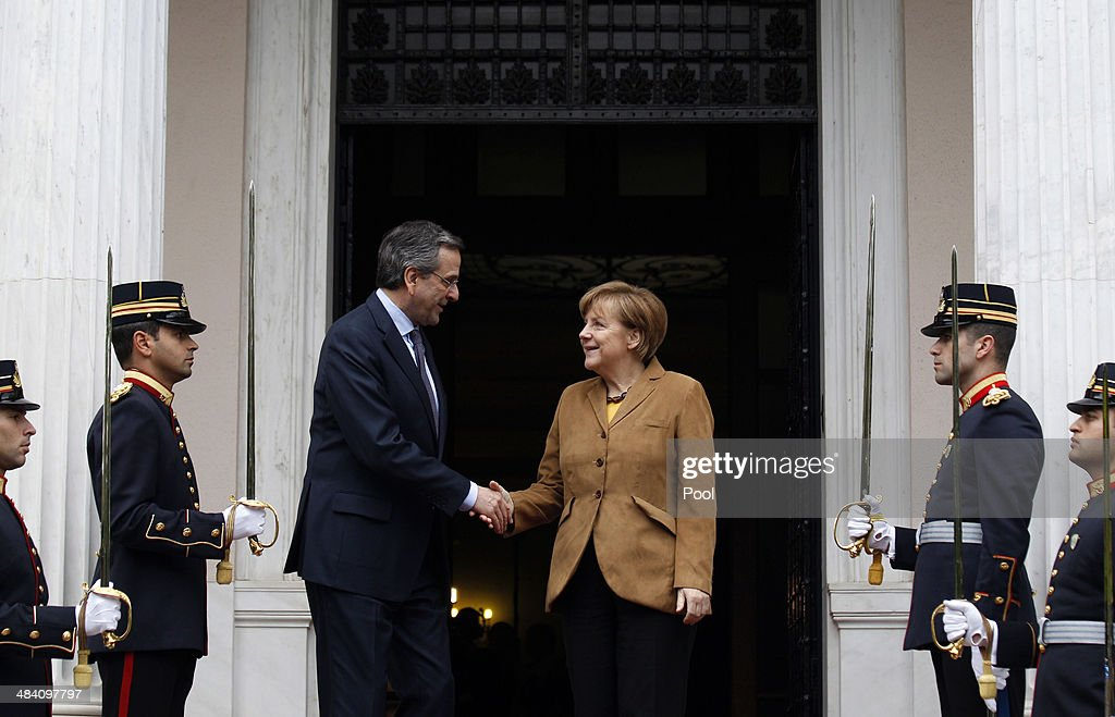 Greek Prime Minister Antonis Samaras greets German Chancellor Angela Merkel on her arrival at the prime minister's office on April 11, 2014 in Athens, Greece. Merkel arrived for a brief visit, a day after the crisis-hit country returned to international bond markets.