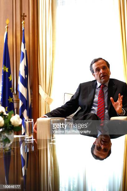Greek Prime Minister Antonis Samaras is pictured in his office in Megaro Maximou on August 21 2012 in Athens Greece German Chancellor Angela Merkel...