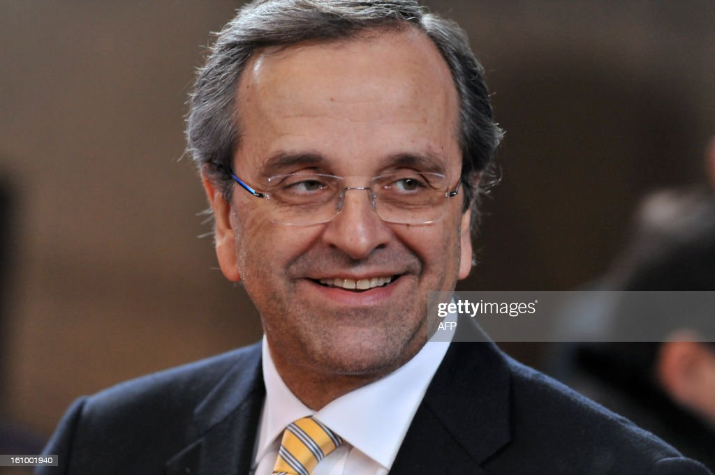Greek Prime Minister Antonis Samaras leaves the EU Headquarters on February 8, 2013 in Brussels, on the last day of a two-day European Union leaders summit. European Union leaders finally clinched a deal on the bloc's next 2014-2020 budget, summit chair and EU president Herman Van Rompuy said Friday. AFP PHOTO / GEORGES GOBET