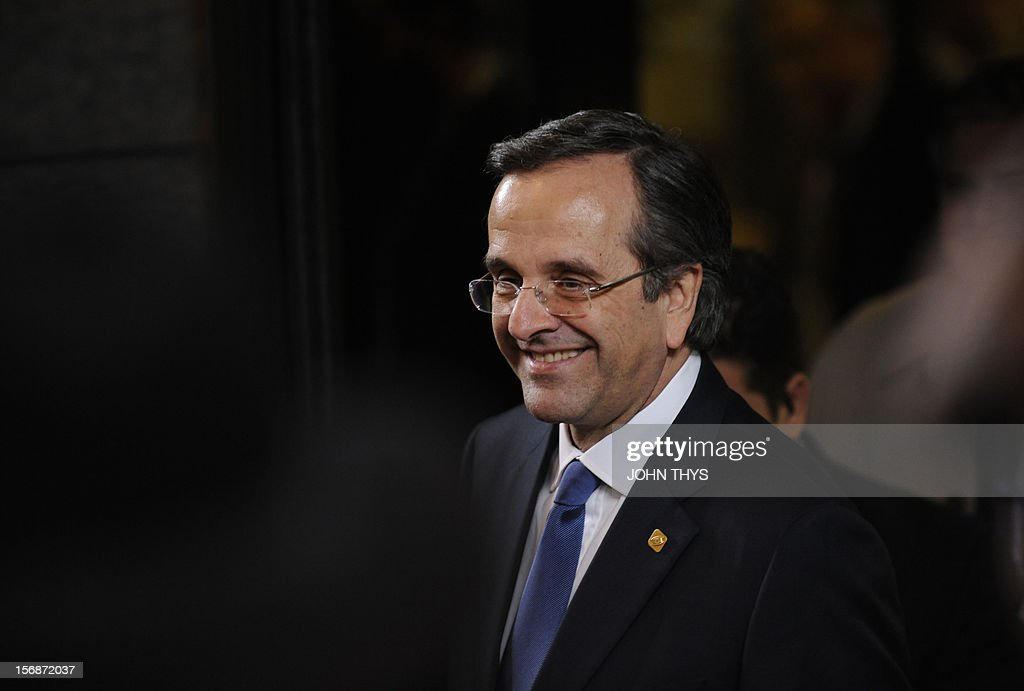 Greek Prime Minister Antonis Samaras leaves the EU Headquarters on November 23, 2012 in Brussels, during a two-day European Union leaders summit called to agree a hotly-contested trillion-euro budget through 2020. European Union officials were scrambling to find an all but impossible compromise on the 2014-2020 budget that could successfully move richer nations looking for cutbacks closer to poorer ones who look to Brussels to prop up hard-hit industries and regions. AFP PHOTO / JOHN THYS