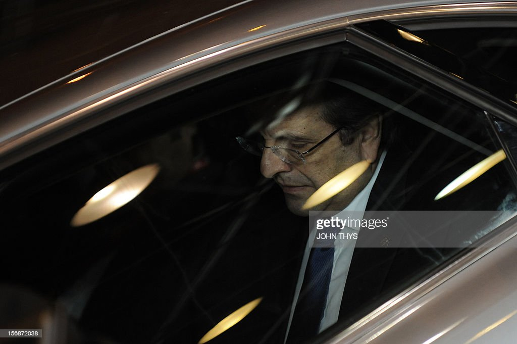 Greek Prime Minister Antonis Samaras leaves the EU Headquarters on November 23, 2012 in Brussels, during a two-day European Union leaders summit called to agree a hotly-contested trillion-euro budget through 2020. European Union officials were scrambling to find an all but impossible compromise on the 2014-2020 budget that could successfully move richer nations looking for cutbacks closer to poorer ones who look to Brussels to prop up hard-hit industries and regions.