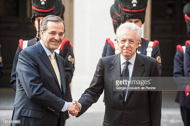 Greek Prime Minister Antonis Samaras shakes hands with Italian Prime Minister Mario Monti before a meeting at Palazzo Chigi on September 21 2012 in...