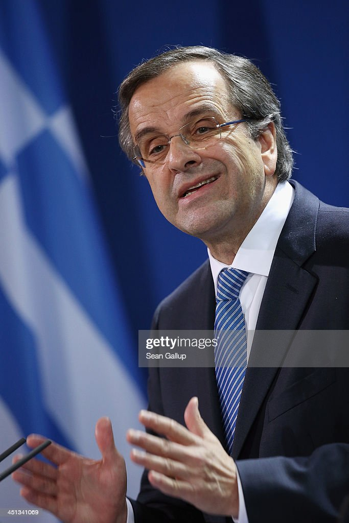 Greek Prime Minister <a gi-track='captionPersonalityLinkClicked' href=/galleries/search?phrase=Antonis+Samaras&family=editorial&specificpeople=970799 ng-click='$event.stopPropagation()'>Antonis Samaras</a> speaks to the media with German Chanellor Angela Merkel (not pictured) following talks at Chancellery (Bundeskanzleramt) on November 22, 2013 in Berlin, Germany. Recent figures suggest the Greek economy is reaching the end of its recession.