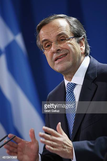 Greek Prime Minister Antonis Samaras speaks to the media with German Chanellor Angela Merkel following talks at Chancellery on November 22 2013 in...