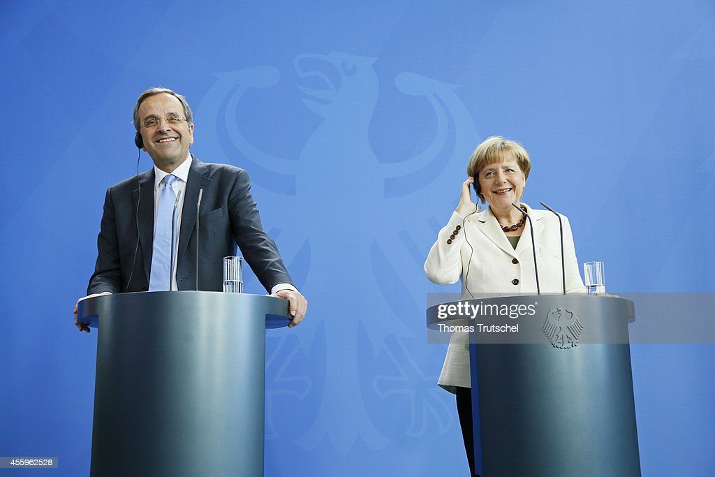 Greek Prime Minister <a gi-track='captionPersonalityLinkClicked' href=/galleries/search?phrase=Antonis+Samaras&family=editorial&specificpeople=970799 ng-click='$event.stopPropagation()'>Antonis Samaras</a> speaks to the media with German Chanellor <a gi-track='captionPersonalityLinkClicked' href=/galleries/search?phrase=Angela+Merkel&family=editorial&specificpeople=202161 ng-click='$event.stopPropagation()'>Angela Merkel</a> following talks at Chancellery (Bundeskanzleramt) on September 23, 2014 in Berlin, Germany.