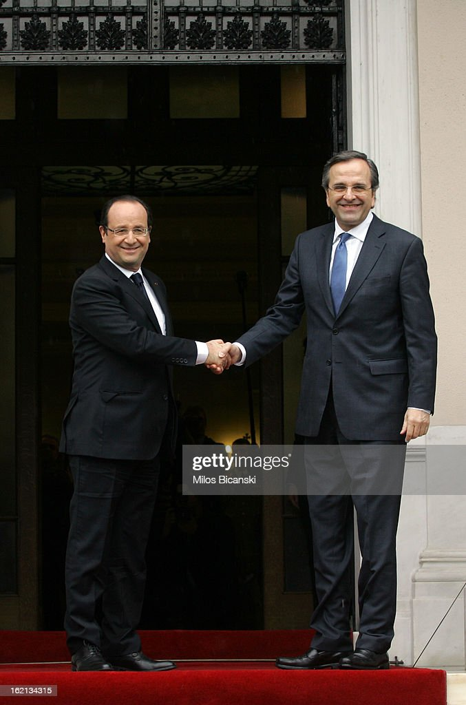 Greek Prime Minister <a gi-track='captionPersonalityLinkClicked' href=/galleries/search?phrase=Antonis+Samaras&family=editorial&specificpeople=970799 ng-click='$event.stopPropagation()'>Antonis Samaras</a> (R) welcomes French President Francois Hollande (L) at Maximos Mansion on February 19, 2013 in Athens, Greece. Hollande arrived in Athens on Tuesday for a brief visit for talks focused on Greece's deep financial crisis.