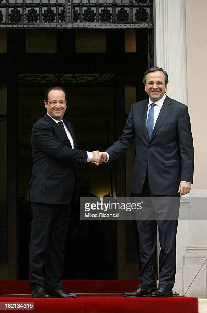 Greek Prime Minister Antonis Samaras welcomes French President Francois Hollande at Maximos Mansion on February 19 2013 in Athens Greece Hollande...