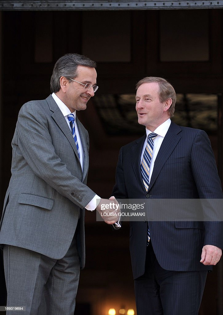 Greek Prime Minister Antonis Samaras (L) welcomes his Irish counterpart, Enda Kenny, whose country has received an international bailout, prior to their talks in Athens as part of a working visit on May 23, 2013.