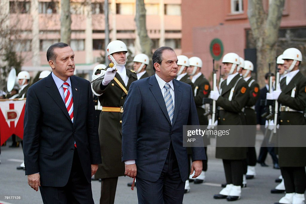 Greek Prime Minister Costas Karamanlis (R) and his Turkish counterpart Tayyip Erdogan (L) inspect a guard of honour during a welcome ceremony in Ankara, 23 January 2008. Greek Prime Minister Costas Karamanlis arrived here Wednesday for a landmark visit, the first to Turkey by a Greek premier in five decades, aiming to boost efforts to bring the two former enemies closer. .