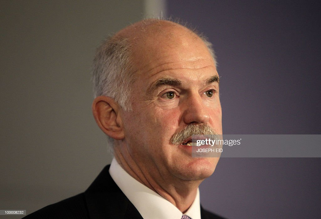 Greek Prime Minister George Papandreou addresses the opening session of the Arab Economic Forum in the Lebanese capital Beirut on May 20, 2010. Greece averted default by tapping into a multi-billion-euro EU loan rescue as unions geared up for a new general strike and official figures showed a strong rise in government debt.