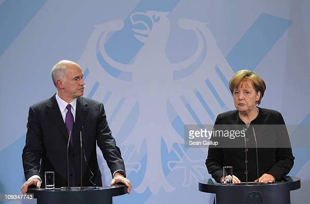 Greek Prime Minister George Papandreou and German Chancellor Angela Merkel speak to the media after talks at the Chancellery on February 22 2001 in...