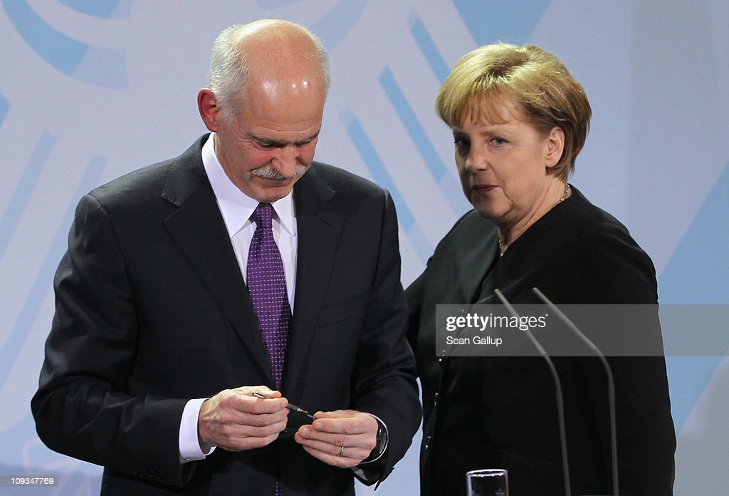 Greek Prime Minister George Papandreou and German Chancellor Angela Merkel depart after speaking to the media after talks at the Chancellery on February 22, 2001 in Berlin, Germany. Papandreou is seeking Merkel's support for the repayment period of Greece's 110 billion Euro crisis loan beyond 2016 and a reduction of the 5% interest rate, as well as to discuss details on a proposed set of measures to help Eurozone members in the future who run into financial hardship.