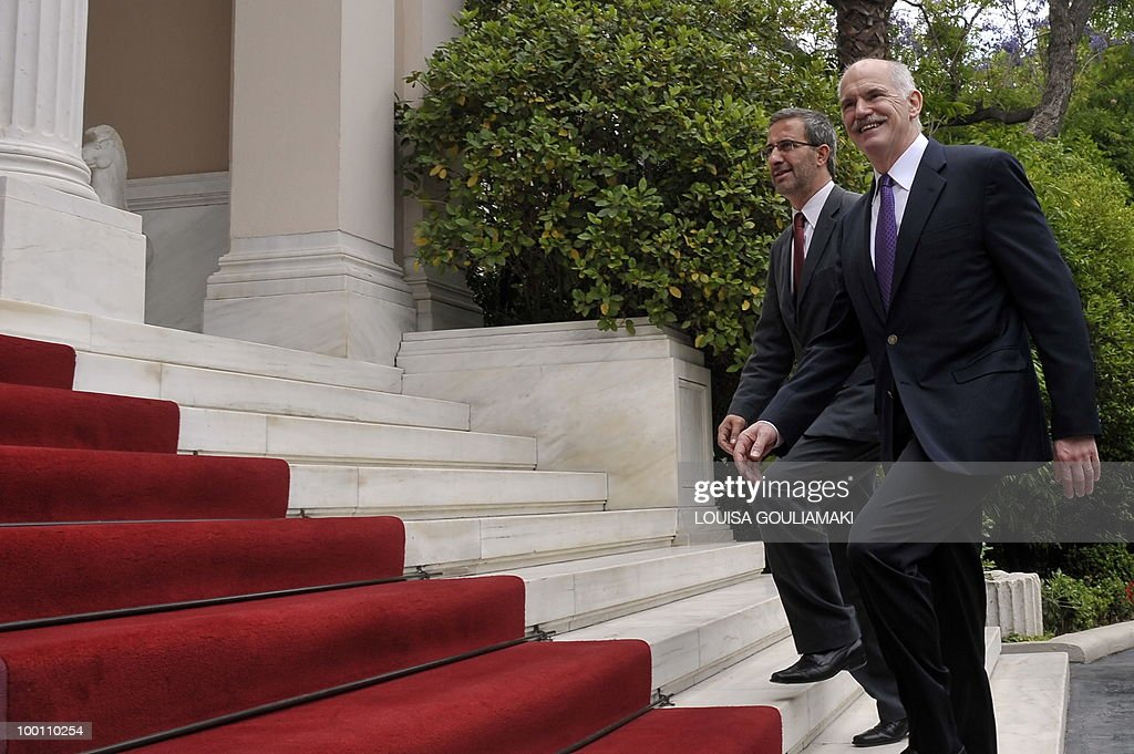 Greek prime minister George Papandreou (R) and his advisor Nikos Ziogas arrive at the prime minister's office in Athens on May 21, 2010. AFP PHOTO / Louisa Gouliamaki