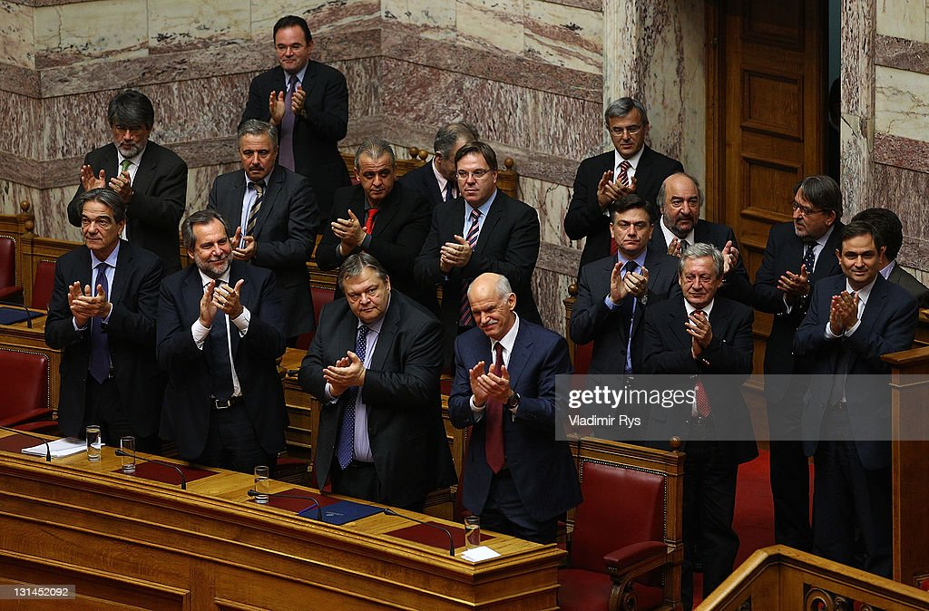 Greek Prime Minister George Papandreou and members of his government applaud after winning the confidence vote in the Greek parliament on November 04, 2011 in Athens, Greece. Papandreou won the parliamentary confidence vote, which is key to Greece receiving a financial aid package worth 130 billion Euros from the E.U. Without this deal sources say Greece will run out of money by the middle of December.