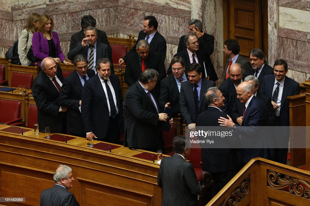 Greek Prime Minister George Papandreou and members of his government congratulate each other after winning the confidence vote in the Greek parliament on November 04, 2011 in Athens, Greece. Papandreou won the parliamentary confidence vote, which is key to Greece receiving a financial aid package worth 130 billion Euros from the E.U. Without this deal sources say Greece will run out of money by the middle of December.