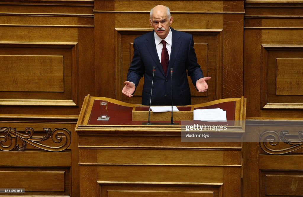 Greek Prime Minister <a gi-track='captionPersonalityLinkClicked' href=/galleries/search?phrase=George+Papandreou&family=editorial&specificpeople=212855 ng-click='$event.stopPropagation()'>George Papandreou</a> delivers his speech ahead of the confidence vote in his government, in the Greek parliament on November 04, 2011 in Athens, Greece. A positive end of the confidence vote is key to Greece receiving a financial aid package worth 130 billion Euros from the E.U. Without this deal sources say Greece will run out of money by the middle of December.