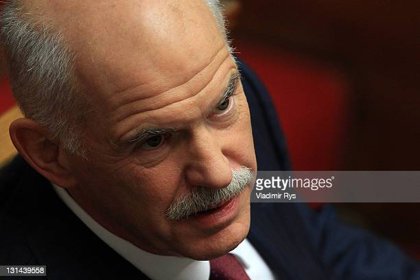 Greek Prime Minister George Papandreou looks on ahead of delivering his speech and the confidence vote in his government in the Greek parliament on...
