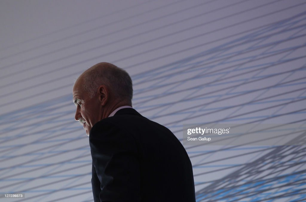 Greek Prime Minister George Papandreou prepares to speak at a convention of the Federation of German Industry (BDI) to appeal for more German investment in Greece on September 27, 2011 in Berlin, Germany. Papandreou later met with German Chancellor Angela Merkel over the current Greek debt crisis that is threatening the stability of the Euro.