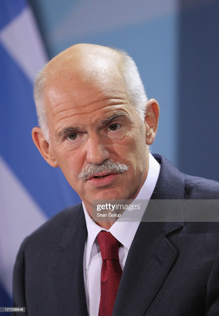 Greek Prime Minister <a gi-track='captionPersonalityLinkClicked' href=/galleries/search?phrase=George+Papandreou&family=editorial&specificpeople=212855 ng-click='$event.stopPropagation()'>George Papandreou</a> speaks to the media prior to talks with German Chancellor Angela Merkel at the Chancellery on September 27, 2011 in Berlin, Germany. The two leaders are meeting to discuss the current Greek debt crisis that is threatening the stability of the Euro two days before the Bundestag is scheduled to vote on an increase in funding for the European Financial Stability Facility (EFSF).