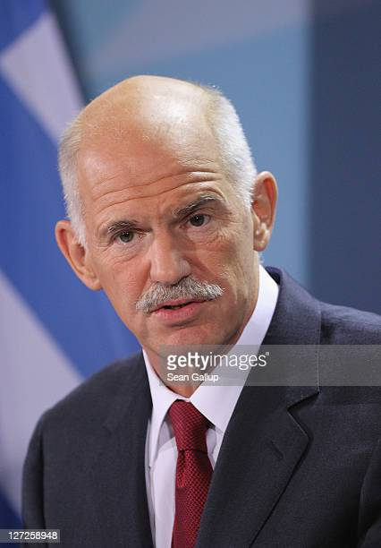 Greek Prime Minister George Papandreou speaks to the media prior to talks with German Chancellor Angela Merkel at the Chancellery on September 27...