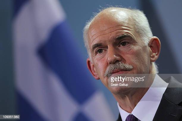 Greek Prime Minister George Papandreou speaks to the media with German Chancellor Angela Merkel after talks at the Chancellery on February 22 2001 in...