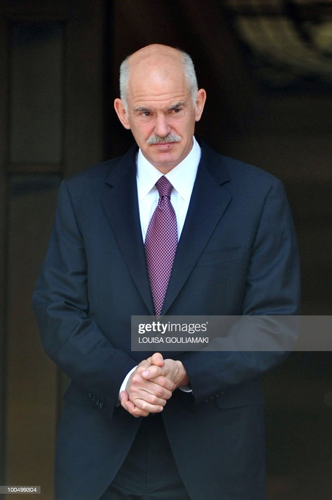 Greek Prime Minister George Papandreou waits for Sheikh Hamad bin Jassim bin Jabr al-Thani, Prime Minister and Foreign Minister of Qatar, prior to their talks in Athens on May 3, 2010. Qatari Premier is in Athens on a two-day visit. AFP PHOTO / Louisa Gouliamaki