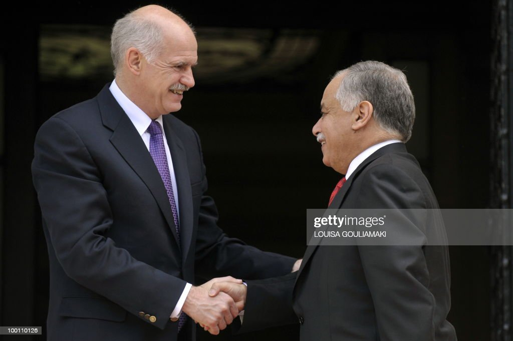 Greek prime minister George Papandreou (R) welcomes his Libyan counterpart, Al-Baghdadi Ali al-Mahmudi prior their talks in Athens on May 21, 2010. AFP PHOTO / Louisa Gouliamaki